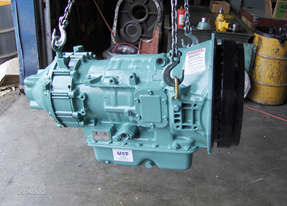 Allison MT Series Model MT654 Transmission suspended by block and tackle